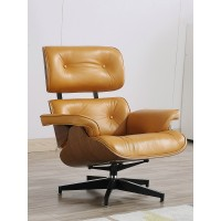 Eames style lounge chair and ottoman in cowhide with maple plywood